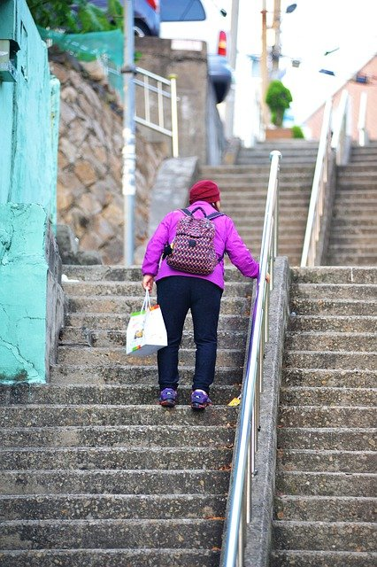 How to get an elderly person up the stairs