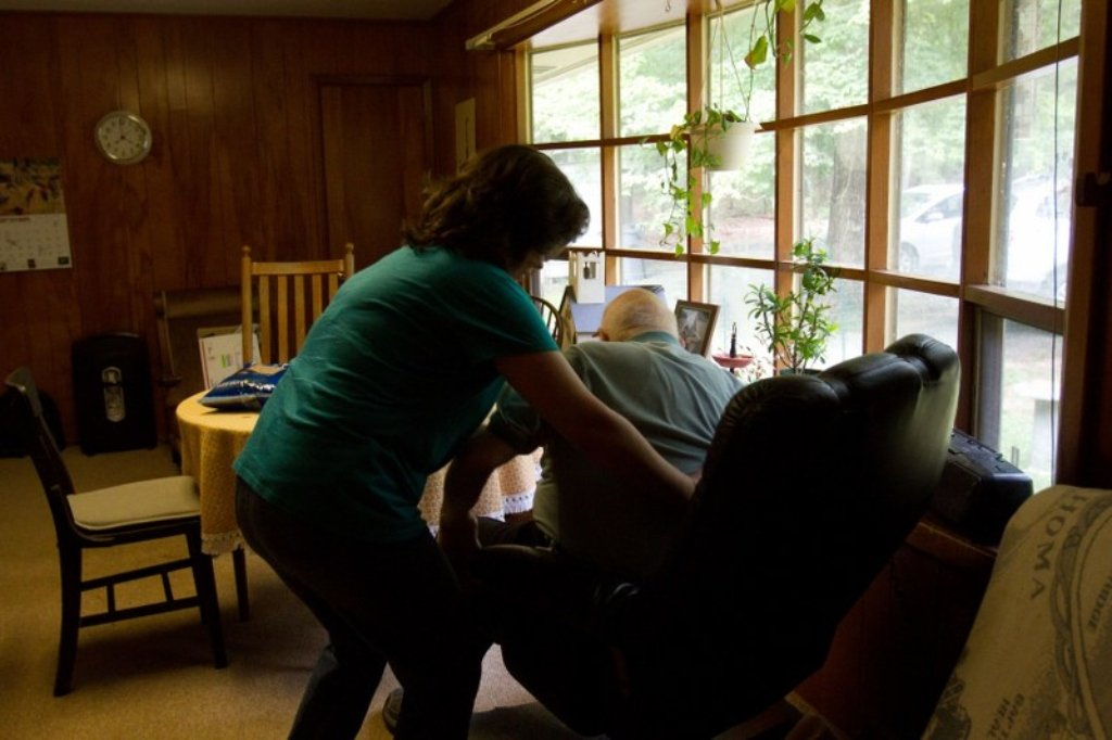 how to help an elderly person up from a chair